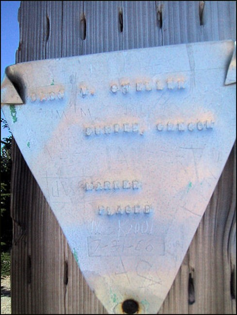 "Aluminum marker reads: ""Gary T. Steller, Dundee, Oregon, Marker Placed, July 31, 1966."""